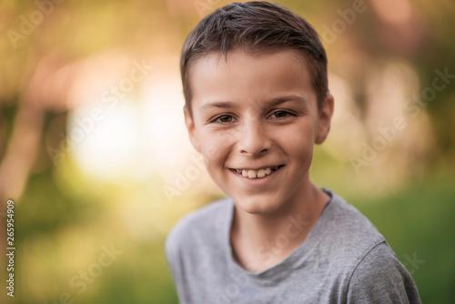 Obraz portrait of a smiling boy - fototapety do salonu