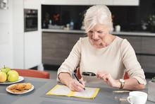 Senior Woman Enjoys Solving A ...