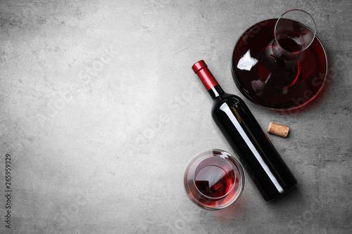 Decanter, glass and bottle with red wine on color background, flat lay Wallpaper Mural