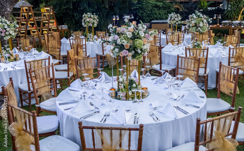 Photo  Wedding outdoor table set up. Beautiful garden wedding venue