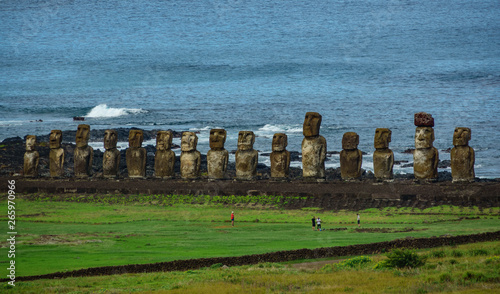 Moai statues on Easter Island with tourists from the distance Canvas Print