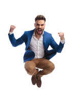 Screaming Man In Suit Jumps With Fists In The Air