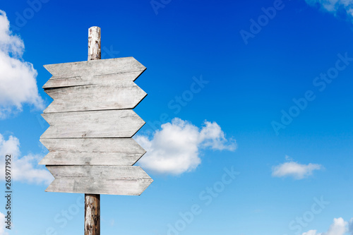 Fotografía signpost on a background of blue sky with clouds