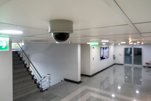 CCTV Ip Camera Hang On The Ceiling Looking At The Stair And Access Control Door For High Security Safety