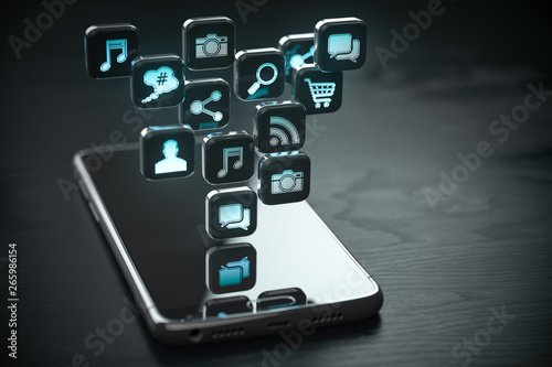 Smartphone with cloud of application icons. Mobile phone on the black wooden background.