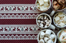 Cups Of Hot Cocoa With Marshmallows And Cream Against Christmas Background. Winter Time. Toned Image. Copy Space For Your Text.