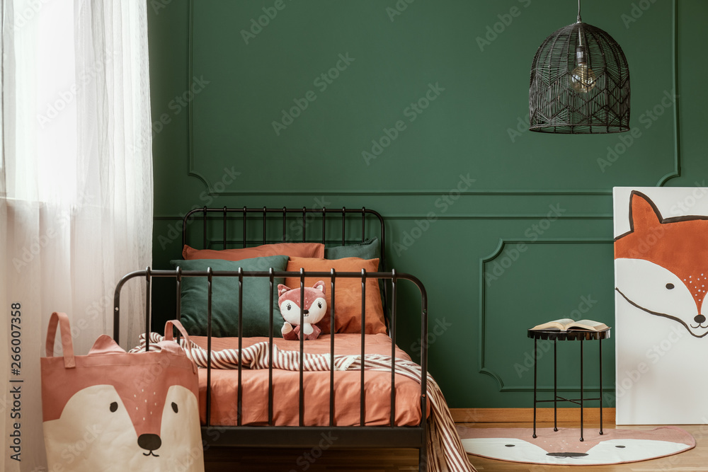 Fototapety, obrazy: Fox-themed kid bedroom interior with molding on green wall and orange sheets on the bed. Real photo