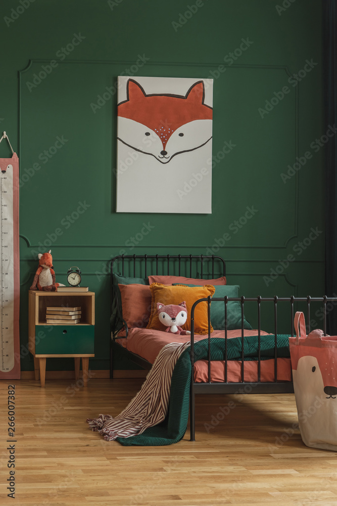 Fototapety, obrazy: Cute fox painting hanging on a dark green wall in a child bedroom interior with metal bed, orange sheets and wooden bedside cabinet. Real photo