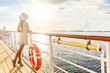 canvas print picture - Luxury cruise ship travel elegant tourist woman watching sunset on balcony deck of Europe mediterranean cruising destination. Summer vacation cruiseship sailing away on holiday.