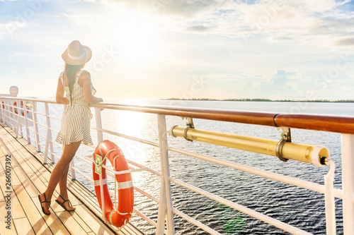 Fotografering Luxury cruise ship travel elegant tourist woman watching sunset on balcony deck of Europe mediterranean cruising destination
