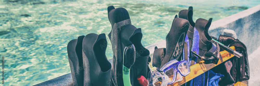 Fototapeta Snorkel fins and mask sets on cruise excursion activity snorkeling from boat in Tropical summer vacation travel destination panoramic banner.