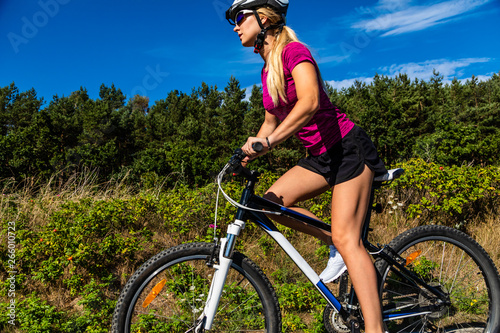 Fototapety, obrazy: Young woman cycling