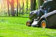 Professional lawn mower wirh worker cut the grass
