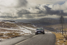 A Car Travelling Down The Dram...