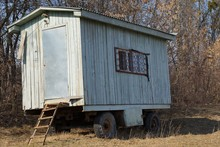 Old Gray Wooden Trailer On Whe...