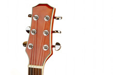 Acoustic Guitar Head On A Whit...