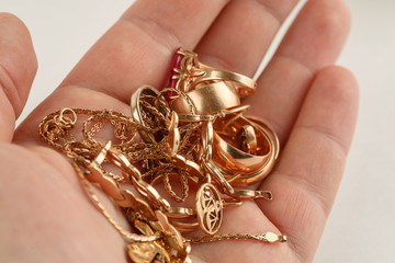 Pile of gold jewellery in h...