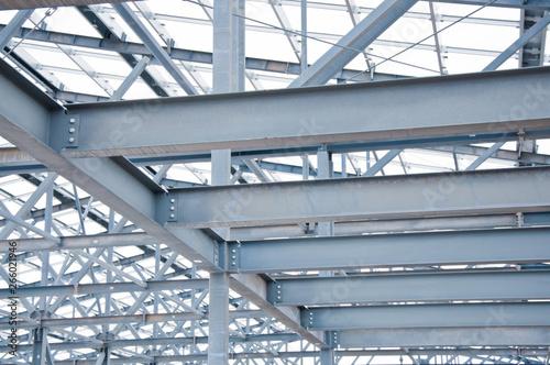 Fototapeta Metal frame of the new building against the sky obraz