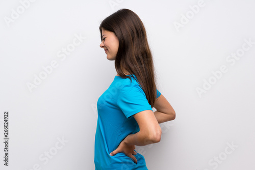 Fotomural Teenager girl with blue shirt suffering from backache for having made an effort