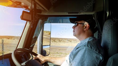 Obraz Truck drivers big truck right-hand traffic of driver's hands on big truck steering wheel - fototapety do salonu