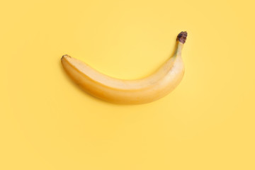 Yellow banana on a yellow background, still life minimalism. Healthy diet