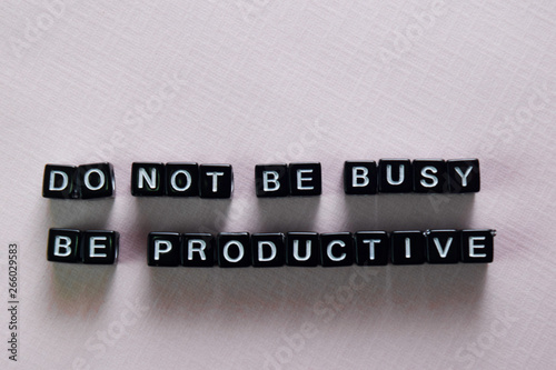 Fototapeta Don't be busy, be productive on wooden blocks. Motivation and inspiration concept obraz