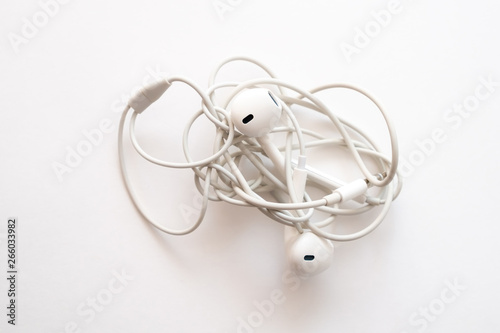 Fototapeta headphones on a white background the wires of the headphones are tangled