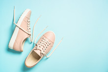 Woman Fashion Pink Shoes On Blue Background.