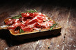 canvas print picture - Italian sliced cured coppa with spices. Raw ham. Crudo or jamon with rosemary