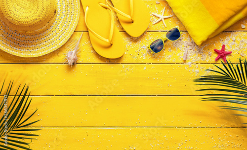 Plakaty żółte  yellow-summer-background-with-beach-accessories-and-palm-leaves