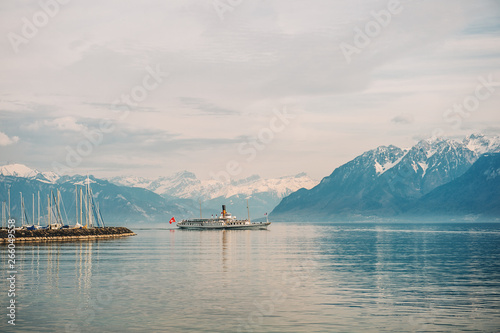Cuadros en Lienzo Steam boat with French and Swiss flags floating on Lake Geneva, Switzerland