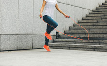 Young Fitness Woman Jumping Ro...
