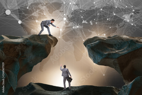 Pinturas sobre lienzo  Businessman helping colleague with rope