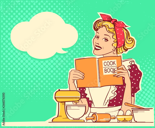 Young woman cooking and holding cook book in her hands on kitchen room Canvas Print