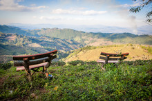 Picturesque View To Doi Mae Salong Valley With Tea Plantations With Wooden Benches On Foreground