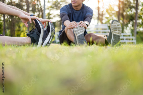 Poster de jardin Vache Early morning workout, Fitness couple stretching outdoors in park. Young man and woman exercising together in morning, Living healthy lifestyle fitness, sport concept.