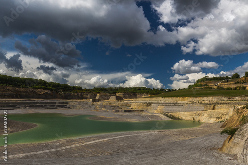 Платно Old marl quarry in Maastricht which is converted into a public park with natural pools, with a dramatic sky