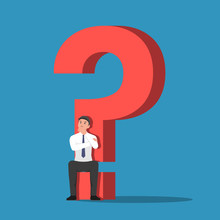 Businessman Sitting On The Base Of Question Mark Sign