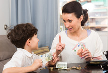 Woman Giving Money And Admonis...