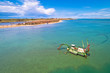 canvas print picture - Dredger boat excavating sand for beach in shallow water near town of Nin