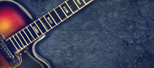 Old Jazz Electro Guitar On A Dark Background. Close Up. Copy Space. Background For Music Festivals, Concerts. Music Background.