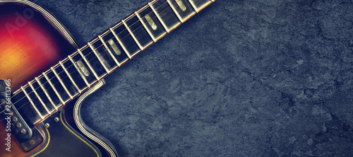 Old jazz electro guitar on a dark background Wallpaper Mural