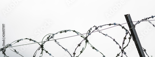 Fotografija  Barbed wire on country border