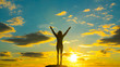 Silhouette of a girl with raised arms goes to the horizon, against the backdrop of a dramatic sky in the sunset. Concept of success and achievement. winner, good luck. Travel outdoors. business
