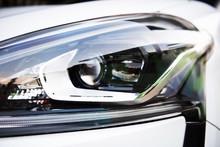 Head Light Of Modern Car Isolated On White