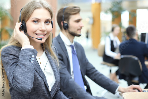 Fototapety, obrazy: Female customer support operator with headset and smiling.