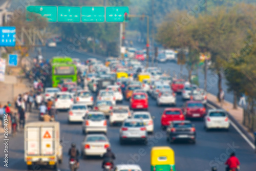 Fototapeta Defocused Picture of India Road Street with Cars, Mopeds and Rickshaws  in New D