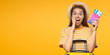 Leinwanddruck Bild - Horizontal banner of excited screaming WOW young woman tourist with suitcase and passport, isolated on yellow background with copy space