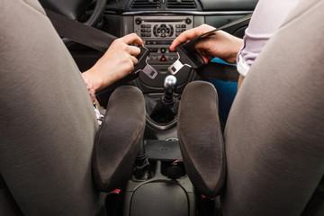 Two people fastening seatbelts
