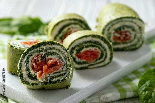 Valokuva  Spinach rolls with smoked salmon and cream cheese.
